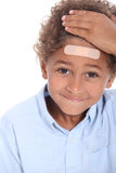 Boy with plaster on head. Little boy with plaster on head royalty free stock photos