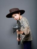 Boy with plastic axe pretending Royalty Free Stock Image