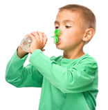 Boy with plastic bottle of water Royalty Free Stock Photography