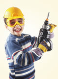 Boy with plastic drilling machine Royalty Free Stock Images