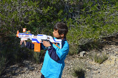 Nerf Gun. A boy aiming a toy Nerf gun Stock Image
