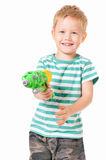 Boy with plastic water gun Royalty Free Stock Image