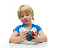 Boy with plasticine Royalty Free Stock Image