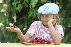 Boy and a plate of cherries. Portrait of a boy with a bowl of cherries Stock Images