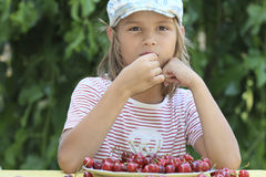 Boy and a plate of cherries. Portrait of a boy with a bowl of cherries Royalty Free Stock Photo