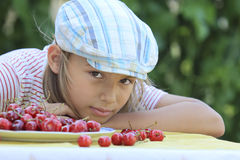 Boy and a plate of cherries. Portrait of a boy with a bowl of cherries Royalty Free Stock Image