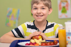 Boy and plate of food Royalty Free Stock Photography