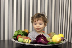 Boy and plate of fruits Royalty Free Stock Photos