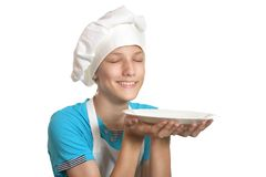 Boy with plate Stock Photos