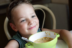 Boy with plate of soup Stock Images