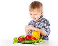 A boy and the plate of vegetables Royalty Free Stock Images