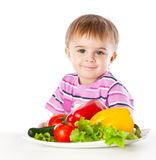 A boy and the plate of vegetables Royalty Free Stock Photography