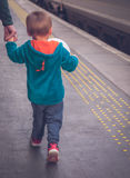 Boy on the platform on the train station Stock Photo