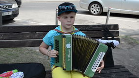 Boy play accordion stock video footage