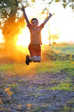 Boy play against the sun Stock Image