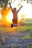 Boy play against the sun Stock Image