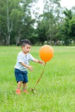Boy play balloon at park. Little boy play balloon at park royalty free stock image