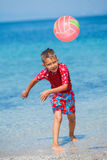 Boy play with a beach ball Stock Photo