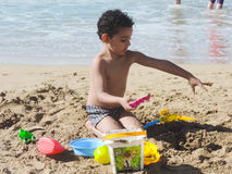 Boy play on beach. Egyptian Family play on the beach of the Mediterranean Sea Royalty Free Stock Images