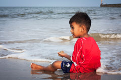 Boy play at the beach Stock Photo