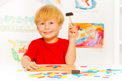Boy play with blocks hammer and nails Royalty Free Stock Photography