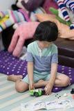 Boy play bricks for car on floor royalty free stock photos
