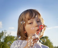 Boy play in bubbles Stock Photo