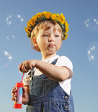 Boy play in  bubbles Stock Photos