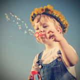 Boy play in  bubbles. Outdoors Royalty Free Stock Photos