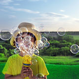 Boy play in  bubbles Royalty Free Stock Photography