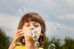 Boy play in bubbles Stock Photography