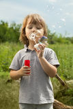Boy play in bubbles Royalty Free Stock Images