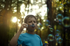 Boy play in bubbles Royalty Free Stock Photo