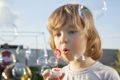 Boy play in bubbles Royalty Free Stock Image