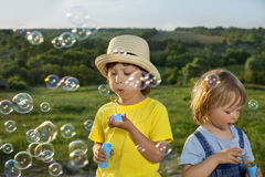 Boy play in bubbles Stock Images