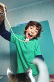 Boy play with cat by rope and mouse toy stock photos