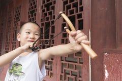 Boy Play Catapult Stock Photography