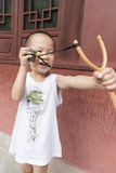Boy play catapult Royalty Free Stock Photography