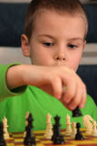 Boy play chess. The boy play chess, close-up royalty free stock photos