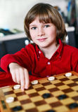 Boy play chess Royalty Free Stock Image