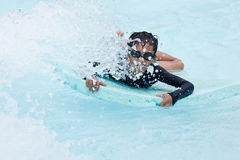 Boy play in clear water Stock Photos