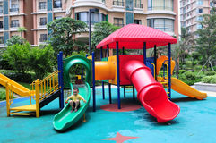 A boy play on the colorful slide Royalty Free Stock Photography