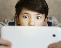 Boy play computer game Stock Photo