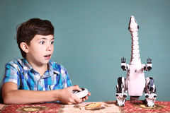 Boy play with dinosaur toy by remote control pult Royalty Free Stock Photo