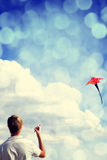 Boy play with fly kite. Stock Photos