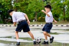Boy play football Stock Photos