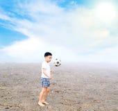 Boy play football Royalty Free Stock Image