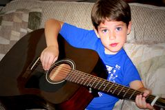 Boy play guitar Stock Photography
