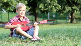 Boy play guitar Stock Photo