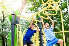Boy play with hang yellow bar. Royalty Free Stock Image